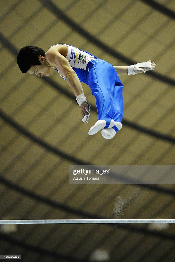 Yusuke Saito of Japan competes on the High Bar during day two of the Artistic Gymnastics NHK Trophy at Yoyogi National Gymnasium on June 8, 2014 in Tokyo, Japan.