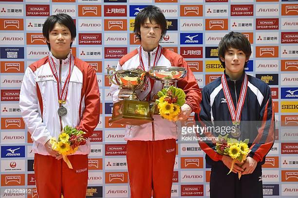 Yusuke Tanaka Kohei Uchimura Ryohei Kato pose for photographs on the podium during day three of the All Japan Artistic Gymnastics Individual All...