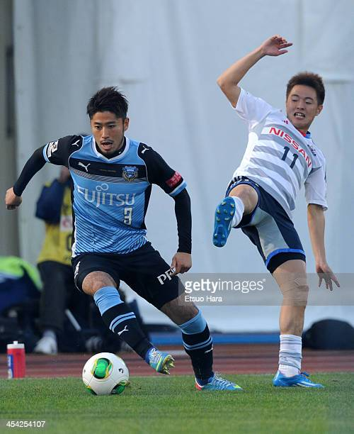 Yusuke Tanaka of Kawasaki Frontale and Manabu Saito of Yokohama FMarinos compete for the ball during the JLeague match between Kawasaki Frontale and...