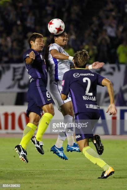Yusuke Tanaka of Ventforet Kofu and Toshihiro Aoyama of Sanfrecce Hiroshima compete for the ball during the JLeague J1 match between Sanfrecce...