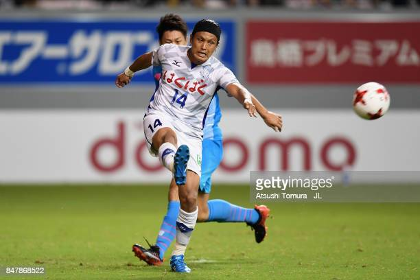 Yusuke Tanaka of Ventforet Kofu clears the ball in front of Yohei Toyoda of Sagan Tosu during the JLeague J1 match between Sagan Tosu and Ventforet...