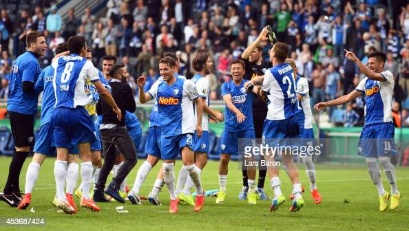 Yusuke Tasaka of Bochum and his team mates celebrate after winning the DFB Cup first round match between VfL Bochum and VfB Stuttgart at Rewirpower...