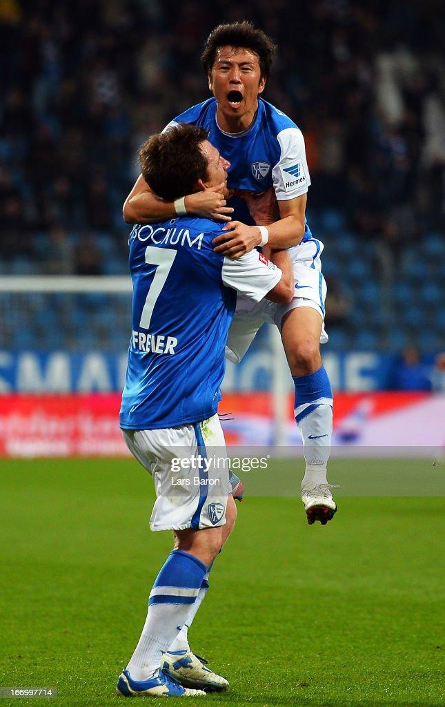 Yusuke Tasaka of Bochum celebrates with team mate Slawo Freier after scoring his teams third goal during the Second Bundesliga match betweeen VfL...