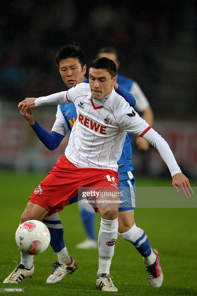 Yusuke Tasaka of Bochum challenges Jonas Hector of Cologne during the Second Bundesliga match between 1. FC Koeln and VfL Bochum at RheinEnergieStadion on November 23, 2012 in Cologne, Germany.
