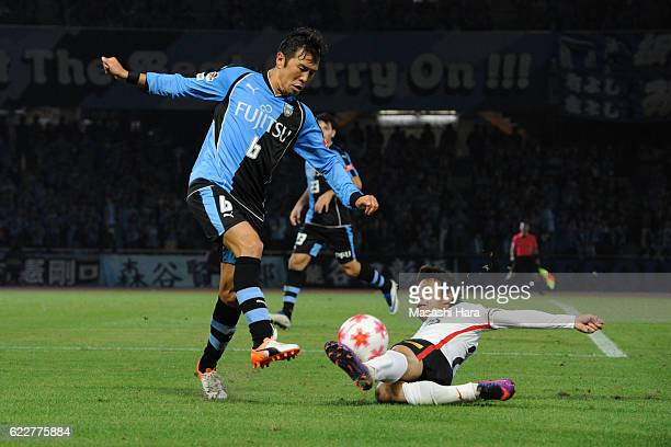 Yusuke Tasaka of Kawasaki Frontale and Takahiro Sekine of Urawa Red Diamonds compete for the ball during the 96th Emperor's Cup fourth round match...