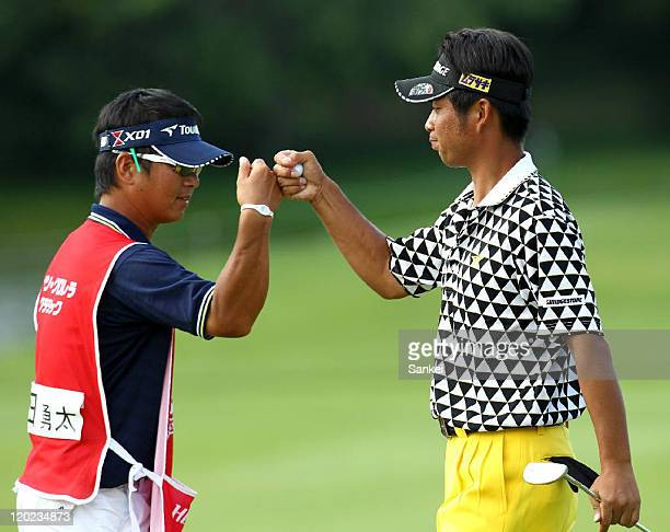 Yuta Ikeda celebrates the birdie with his caddie on the 17th green during the final round of the Sun Chlorella Classic at Otaru Country Club on July...