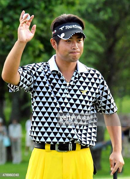 Yuta Ikeda of Japan acknowledges the crowd after holing the winning putt on the 18th green during the final round of the San Chlorella Classic at...