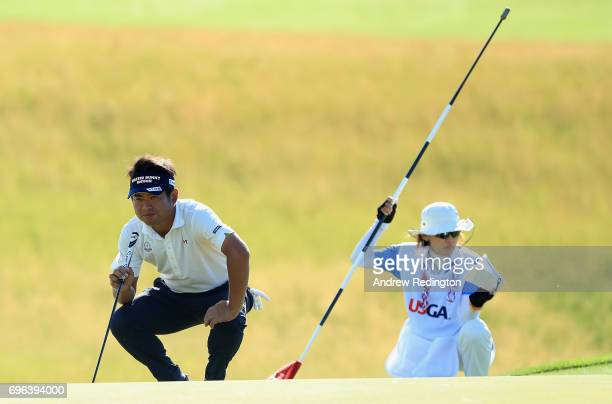 Yuta Ikeda of Japan lines up a putt on the 18th green during the first round of the 2017 US Open at Erin Hills on June 15 2017 in Hartford Wisconsin