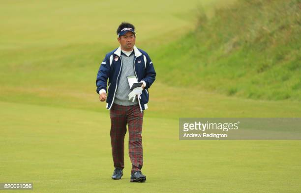 Yuta Ikeda of Japan looks at his yardage book on the 1st hole during the second round of the 146th Open Championship at Royal Birkdale on July 21...