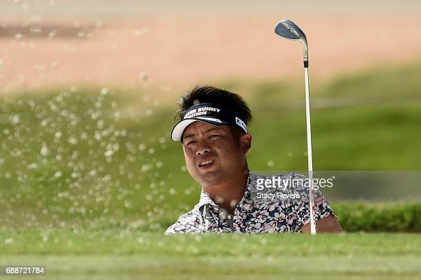 Yuta Ikeda of Japan plays a shot from a bunker on the fifth hole during Round Two of the DEAN DELUCA Invitational at Colonial Country Club on May 26...