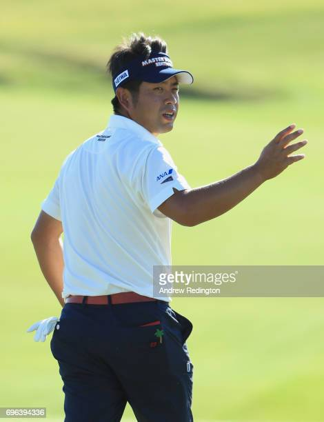 Yuta Ikeda of Japan reacts after making a birdie on the 18th green during the first round of the 2017 US Open at Erin Hills on June 15 2017 in...