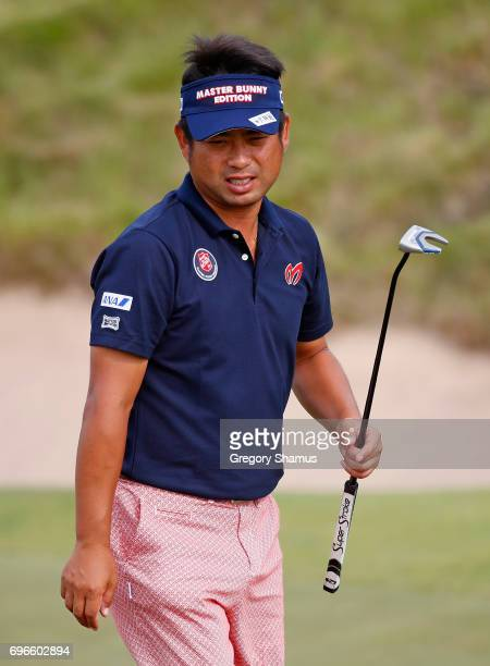 Yuta Ikeda of Japan reacts after making par on the 16th green during the second round of the 2017 US Open at Erin Hills on June 16 2017 in Hartford...