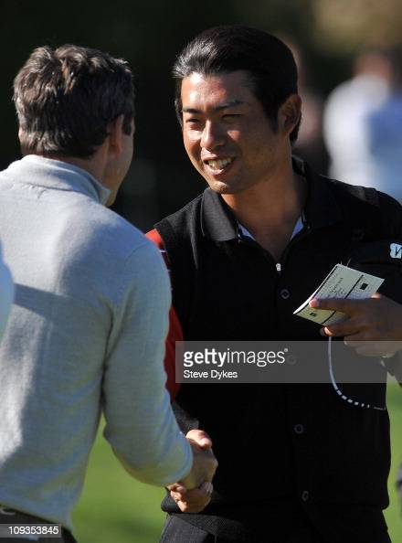 Yuta Ikeda of Japan shakes hands with fellow golfer Mark Wilson on the 9th hole to after they finished their round during the final round of the...