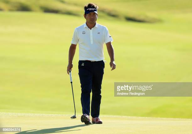 Yuta Ikeda of Japan walks across the 18th green during the first round of the 2017 US Open at Erin Hills on June 15 2017 in Hartford Wisconsin