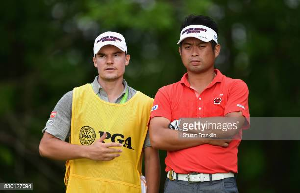 Yuta Ikeda of Japan with his caddie Luis Hernandez during the second round of the 2017 PGA Championship at Quail Hollow Club on August 11 2017 in...