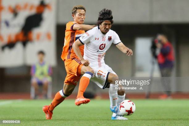 Yuta Ito of Albirex Niigata and Kei Koizumi of Albirex Niigata compete for the ball during the JLeague J1 match between Albirex Niigata and Omiya...