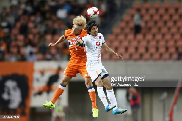 Yuta Ito of Albirex Niigata and Song Ju Hun of Albirex Niigata compete for the ball during the JLeague J1 match between Albirex Niigata and Omiya...