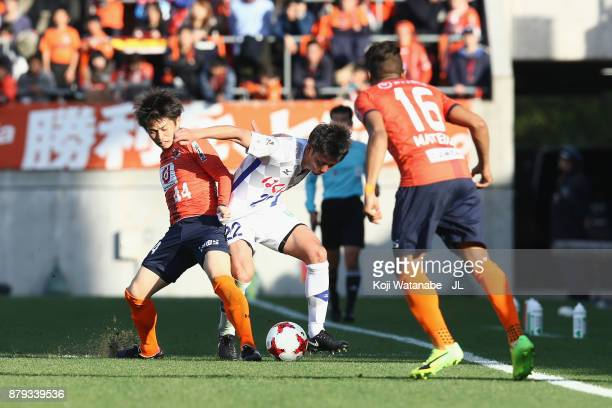 Yuta Koide of Ventforet Kofu and Yusuke Segawa of Omiya Ardija compete for the ball during the JLeague J1 match between Omiya Ardija and Ventforet...