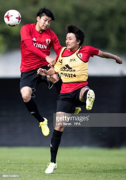 Yuta Nakayama of Japan goes up for a header with Teruki Hara of Japan during a Japan training session for the FIFA U20 World Cup Korea Republic at...