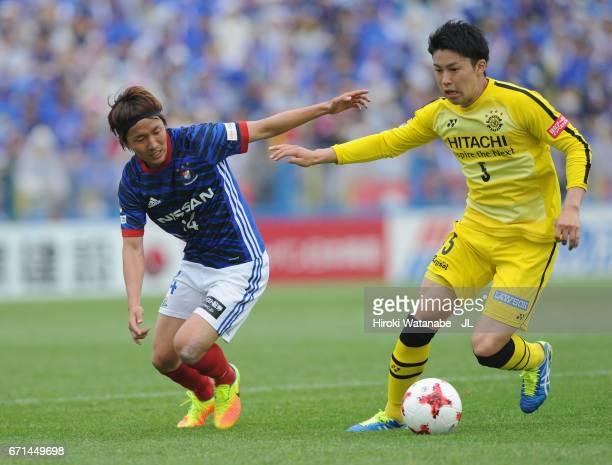 Yuta Nakayama of Kashiwa Reysol and Jun Amano of Yokohama FMarinos compete for the ball during the JLeague J1 match between Kashiwa Reysol and...