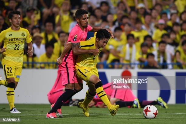 Yuta Nakayama of Kashiwa Reysol and Pedro Junior of Kashima Antlers compete for the ball during the JLeague J1 match between Kashiwa Reysol and...