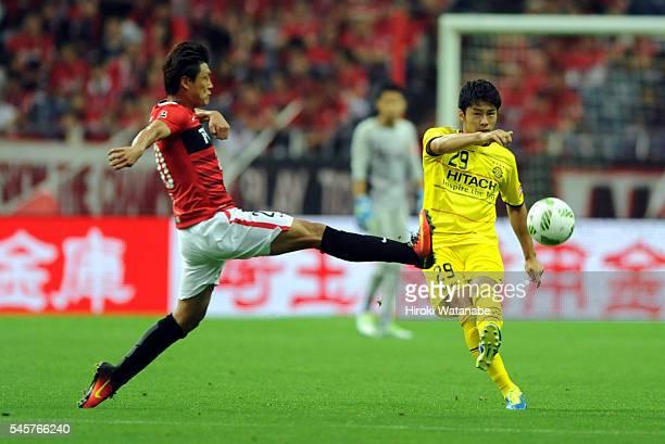 Yuta Nakayama of Kashiwa Reysol and Tadanari Lee of Urawa Red Diamonds compete for the ball during the JLeague match between Urawa Red Diamonds and...