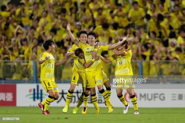 Yuta Nakayama of Kashiwa Reysol celebrates scoring his side's third goal with his team mates during the JLeague J1 match between Kashiwa Reysol and...
