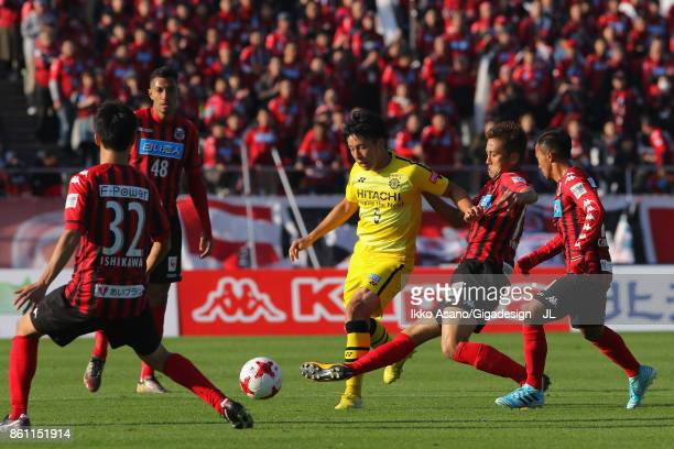 Yuta Nakayama of Kashiwa Reysol controls the ball under pressure of Consadole Sapporo defense during the JLeague J1 match between Consadole Sapporo...