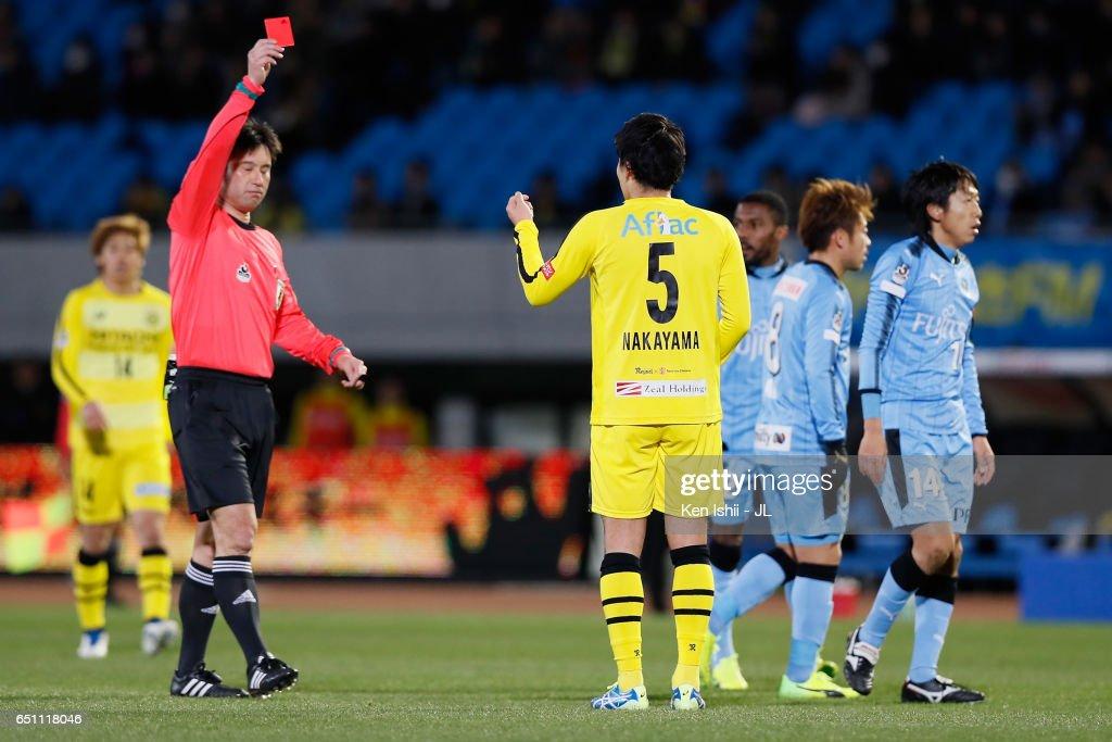 Yuta Nakayama of Kashiwa Reysol is shown a red card by referee Yoshiro Imamura after fouling on Kengo Nakamura of Kawasaki Frontale during the J.League J1 match between Kawasaki Frontale and Kashiwa Reysol at Todoroki Stadium on March 10, 2017 in Kawasaki, Kanagawa, Japan.