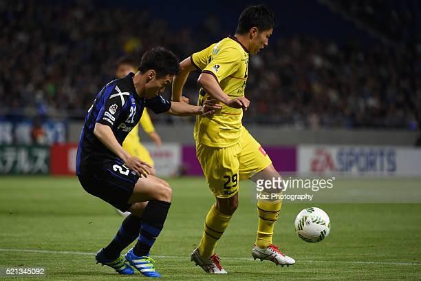 Yuta Nakayama of Kashiwa Reysol keeps the ball under the pressure from Oh Jae Suk of Gamba Osaka during the JLeague match between Gamba Osaka and...
