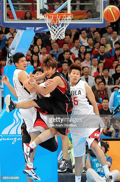 Yuta Tabuse of Japan competes for the ball in the Men's Basketball semi final match between South Korea and Japan during day thirteen of the...