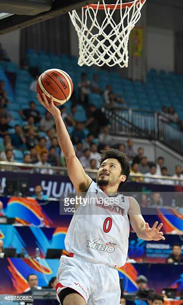 Yuta Tabuse of Japan shoots the ball during the 2015 FIBA Asia Championship Group A match between Japan and Malaysia at Changsha Social Work...