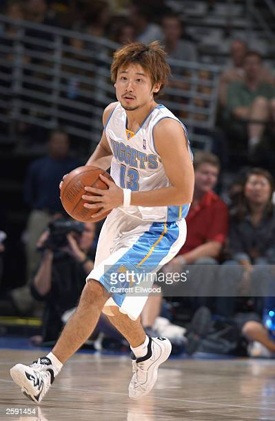 Yuta Tabuse of the Denver Nuggets looks to pass during the NBA preseason game against the Phoenix Suns at Pepsi Center on October 9 2003 in Denver...
