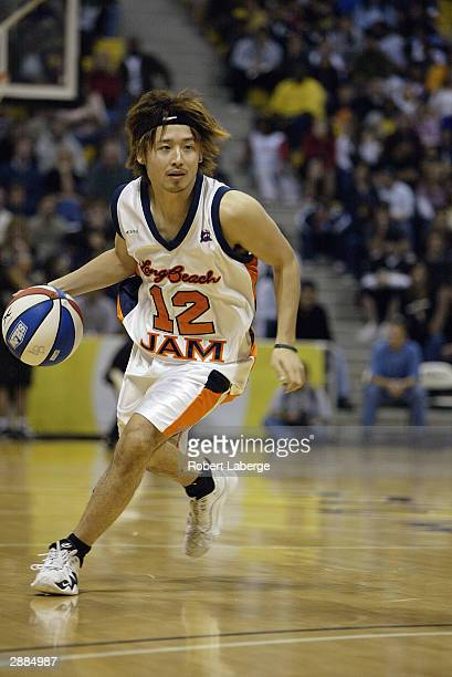 Yuta Tabuse of the Long Beach Jam drives upcourt during the game against the Fresno Heat at The Pyramid on January 16 2004 in Long Beach California...