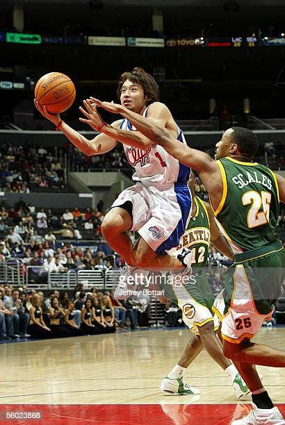 Yuta Tabuse of the Los Angeles Clippers puts up a shot against Alex Scales of the Seattle SuperSonics during a preseason game on October 27 2005 at...