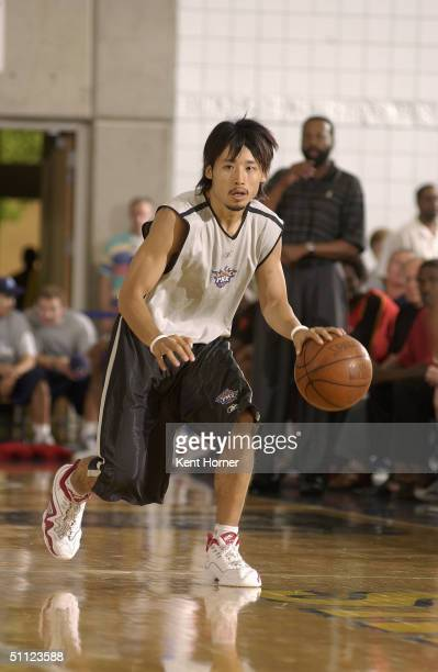 Yuta Tabuse of the Phoenix Suns dribbles the ball against the Atlanta Hawks during the Rocky Mountain Review Summer League at Salt Lake City...