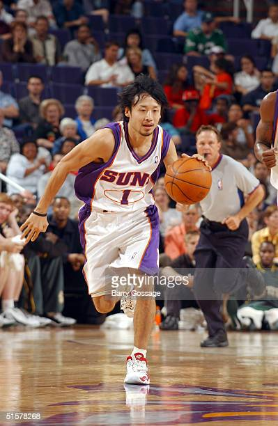 Yuta Tabuse of the Phoenix Suns drives against the Seattle SuperSonics on October 26 2004 at America West Arena in Phoenix Arizona NOTE TO USER User...