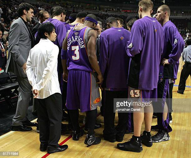 Yuta Tabuse of the Phoenix Suns listens as his teammates prepare to take on the Chicago Bulls on November 9 2004 at the United Center in Chicago...