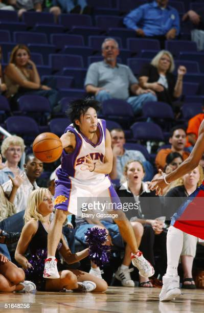 Yuta Tabuse of the Phoenix Suns makes a pass against the Los Angeles Clippers on October 13 2004 at America West Arena in Phoenix Arizona The Suns...
