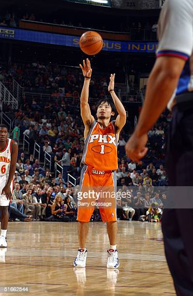 Yuta Tabuse of the Phoenix Suns scores the first point by a player from Japan in an NBA game against the Atlanta Hawks on November 3 2004 at America...