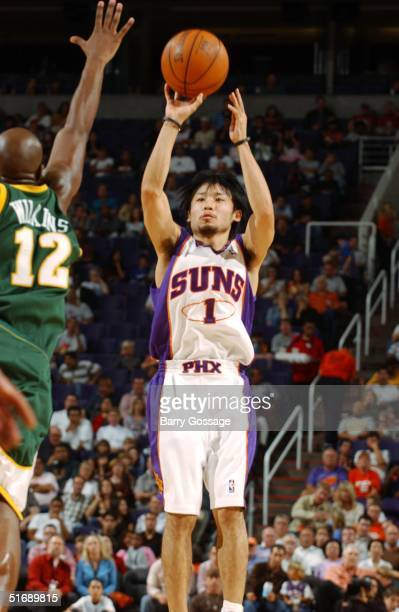 Yuta Tabuse of the Phoenix Suns shoots on Damien Wilkins of the Seattle Sonics during the preseason game at America West Arena on October 26 2004 in...