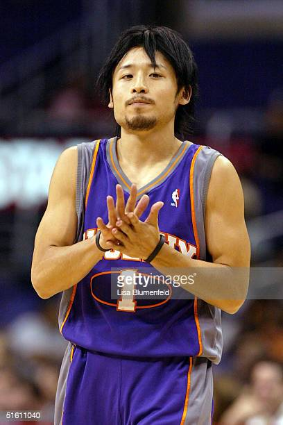 Yuta Tabuse of the Phoenix Suns walks upcourt during a preseason game against the Los Angeles Clippers on October 28 2004 at Staples Center in Los...