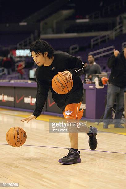 Yuta Tabuse of the Phoenix Suns warms up before playing against the Los Angeles Lakers during the game at Staples Center on December 8 2004 in Los...