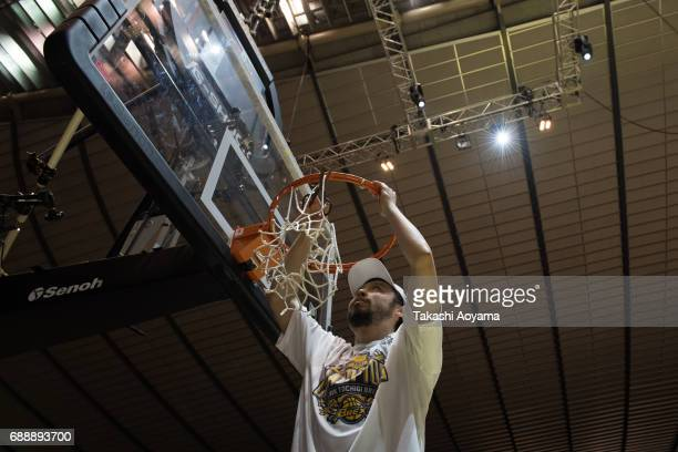 Yuta Tabuse of the Tochigi Brex cuts down the net after defeating the Kawasaki Brave Thunders in the the B League final match between Kawasaki Brave...