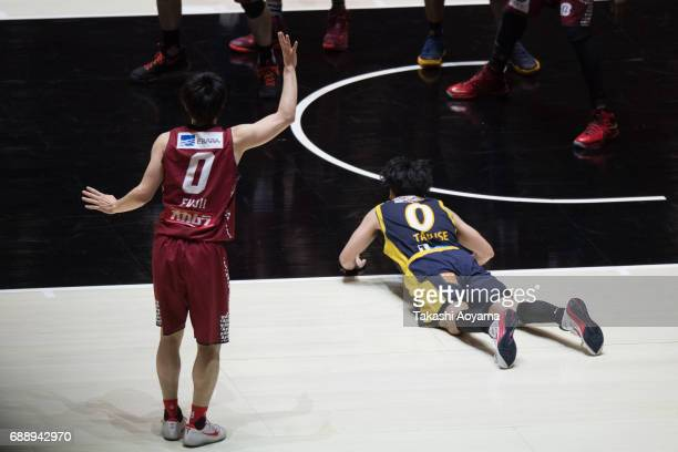 Yuta Tabuse of the Tochigi Brex is fouled by Yuma Fujii of the Kawasaki Brave Thunders during the B League final match between Kawasaki Brave...