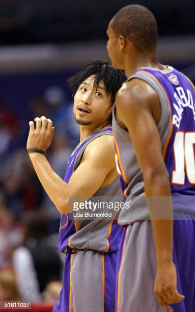 Yuta Tabuse talks to teammate Leandro Barbosa of the Phoenix Suns during a preseason game against the Los Angeles Clippers on October 28 2004 at...