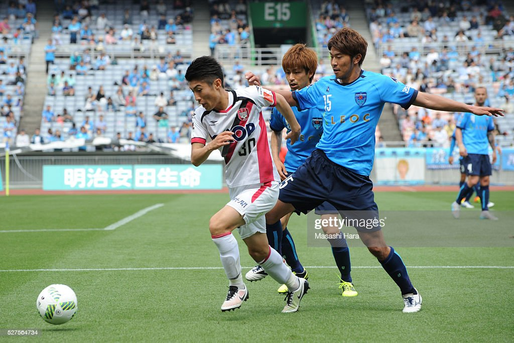 <a gi-track='captionPersonalityLinkClicked' href=/galleries/search?phrase=Yuta+Toyokawa&family=editorial&specificpeople=12516123 ng-click='$event.stopPropagation()'>Yuta Toyokawa</a> #30 of Fagiano Okayama in action during the J.League second division match between Yokohama FC and Fagiano Okayama at the Nissan Stadium on May 3, 2016 in Yokohama, Kanagawa, Japan.