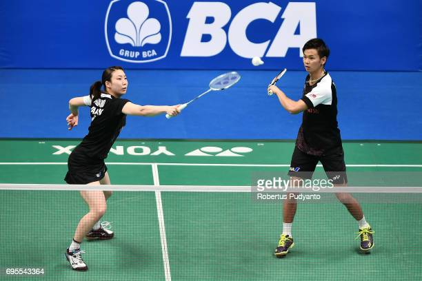 Yuta Watanabe and Arisa Higashino of Japan compete against Edi Subaktiar and Gloria Emanuelle Widjaja of Indonesia during Mixed Doubles Round 1 match...