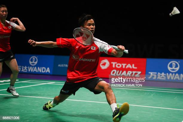 Yuta Watanabe of Japan hits a return during the mixed doubles Sudirman Cup match with partner Arisa Higashino against China's Zheng Siwei and Chen...