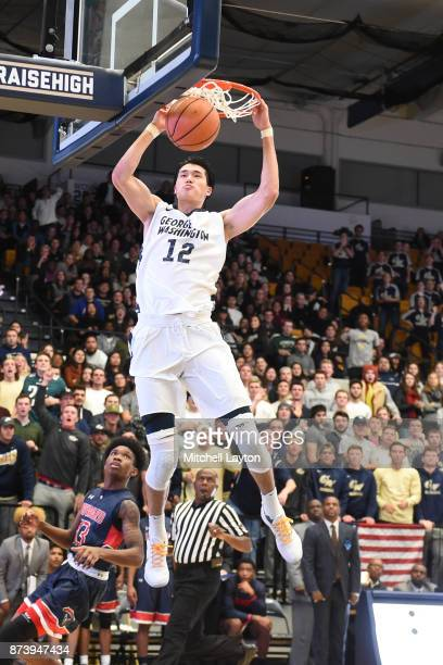Yuta Watanabe of the George Washington Colonials dunks the ball during a college basketball game against the Howard Bison at the Smith Center on...